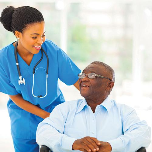 Nurse assisting a patient in hosiptal